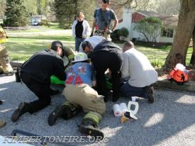 Crews working on packaging the patient on the street.