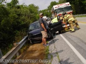 Fire & EMS Crews work to remove injured driver