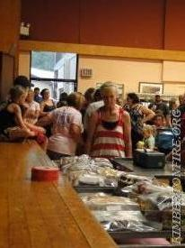 A quick Pic of the Bake goods auction that followed the opening ceremonies.  Volunteers spent over an hour auctioning off tasty baked goods.
