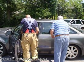 Kimberton Firefighter Bonsall evaluates the driver of the gray Ford.
