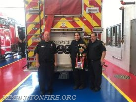 Captain Dave Smith, Engineer Ashley Marchetti and Robert Gable display the Trophy at the Royersford Fire Station.
