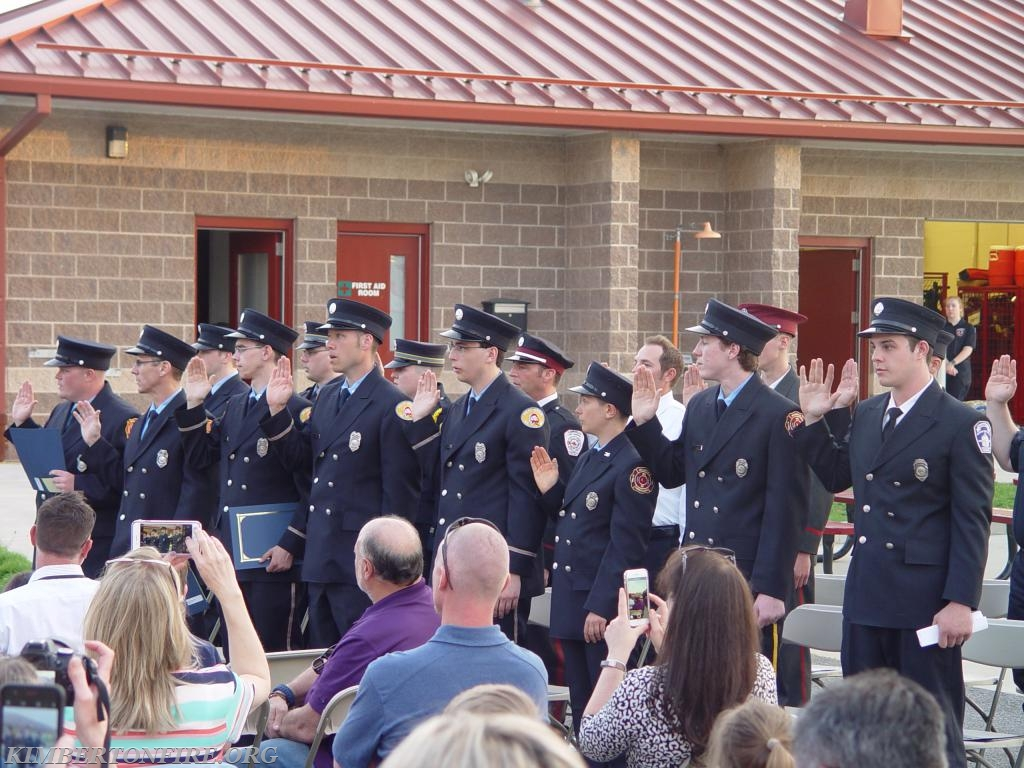 The firefighters are sworn in and take the Oath.