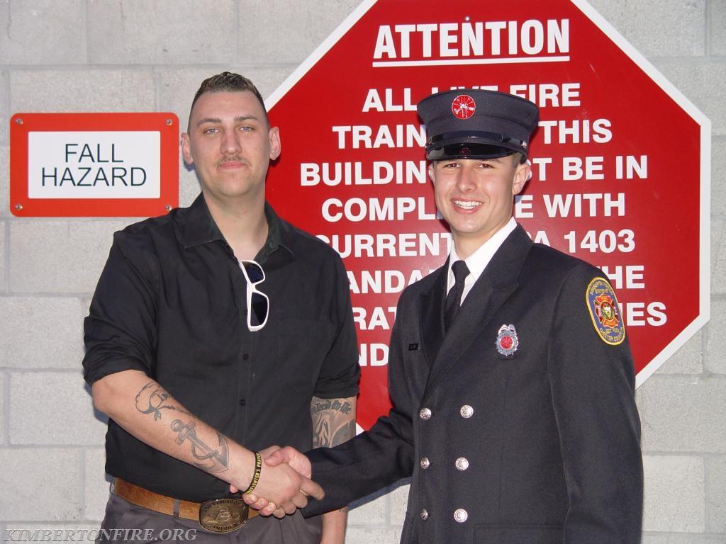 Firefighter Matt Brown with Tyler