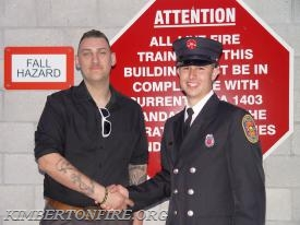 Firefighter Matt Brown with Tyler