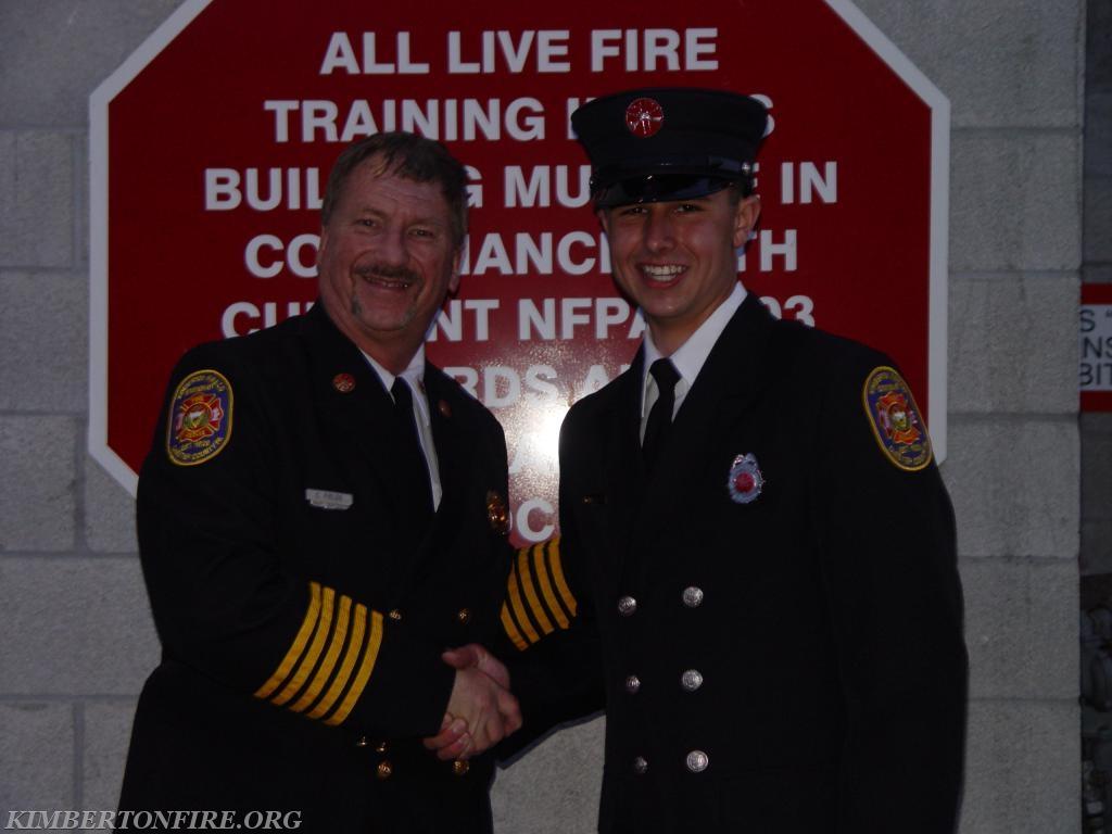 Deputy Fire Chief Chuck Fields with Tyler Bauer