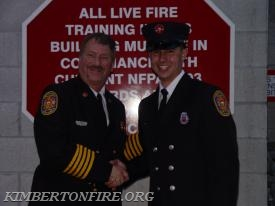 Deputy Fire Chief Chuck Fields with Tyler Bauer