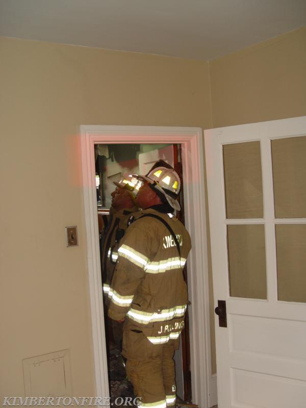 Chief Pollinger at doorway to bathroom.