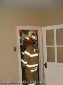 Chief Pollinger at doorway to bathroom.