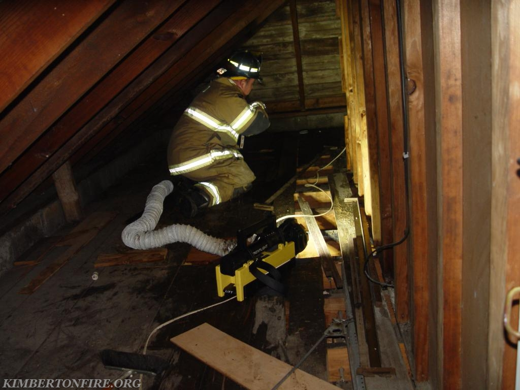 Captain Dave Smith works in attic area