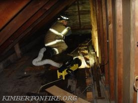 Captain Dave Smith works in attic area