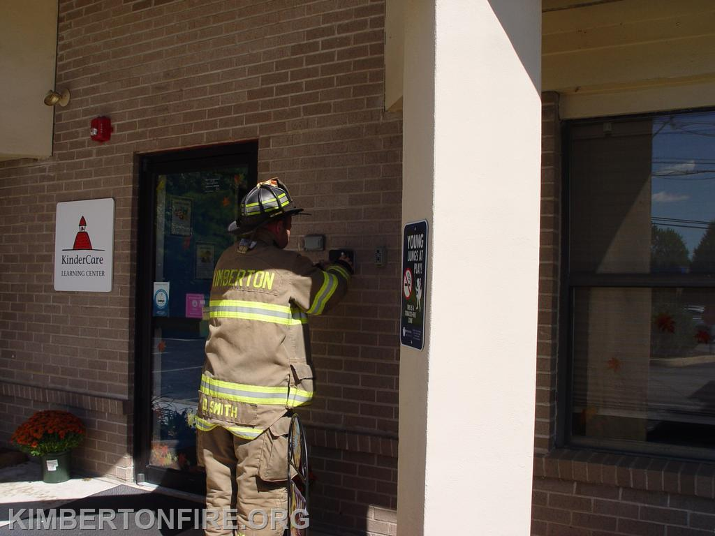 Firefighter Dave Smith uses the FD Knox (Key) Box to get into the building